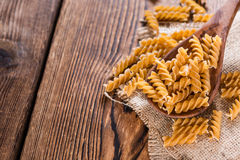 Portion of Fussili (Whole Grain). On an old rustic wooden table Stock Photos