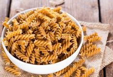Portion of Fussili (Whole Grain). On an old rustic wooden table Stock Photography