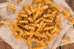 Portion of Fussili (Whole Grain). On an old rustic wooden table Royalty Free Stock Photography
