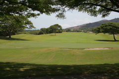 Portion of a golf course in central Maui, Hawaii. View looking west across the greens and rough of a golf course in central Maui, Hawaii Stock Photography