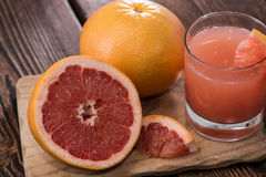 Portion of Grapefruit Juice Stock Images