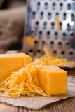 Portion of grated Cheddar Stock Photography