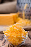 Portion of grated Cheddar Stock Photo