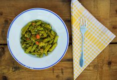 Plate of green beans. Portion of green beans on rustic wooden table Royalty Free Stock Photo