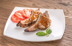 Portion of grilled pork ribs Stock Photos