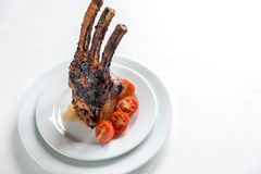 Portion of grilled pork ribs. On the white background Royalty Free Stock Image