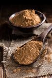 Portion of Guarana Powder. On dark wooden background (close-up shot royalty free stock photography