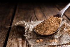 Portion of Guarana Powder. On dark wooden background (close-up shot royalty free stock photos
