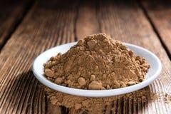 Portion of Guarana Powder. On dark wooden background (close-up shot royalty free stock photo