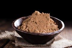 Portion of Guarana Powder. On dark wooden background (close-up shot stock photo