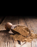 Portion of Guarana Powder. On dark wooden background (close-up shot royalty free stock images