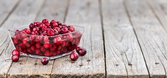 Preserved Cranberries selective focus; detailed close-up shot. Portion of healthy Cranberries preserved selective focus; close-up shot royalty free stock images