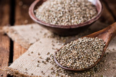 Portion of Hemp Seeds. (close-up shot) on an old wooden table royalty free stock images