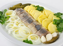 Portion of herring fish fillets. With potato and onion Stock Photos
