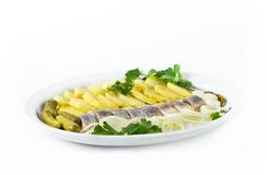 Portion of herring fish fillets with potato. And onion Royalty Free Stock Images