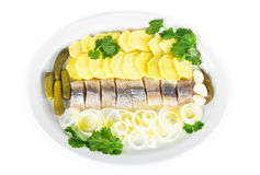 Portion of herring fish fillets with potato onion Royalty Free Stock Photos