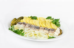 Portion of herring fish fillets with potato onion Stock Photography