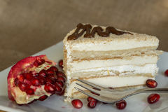 Portion homemade cream cake with pomegranate seeds and chocolate spread Stock Images