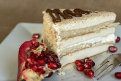 Portion homemade cream cake with pomegranate seeds and chocolate spread Royalty Free Stock Photos