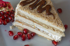 Portion homemade cream cake with pomegranate seeds and chocolate spread Stock Photography