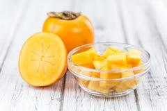 Portion of Kaki fruits Royalty Free Stock Photography