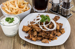 Portion of Kebab meat with French Fries Royalty Free Stock Photos
