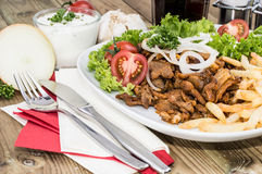 Portion of Kebab meat on a plate Royalty Free Stock Images