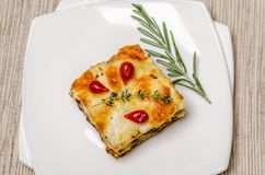 Portion of lasagna on the square plate Royalty Free Stock Images