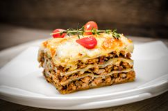 Portion of lasagna on the square plate Royalty Free Stock Photos