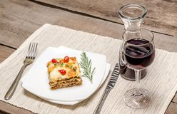 Portion of lasagna on the wooden table Stock Photo