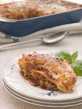 Portion of Lasagne with Basil Royalty Free Stock Photography