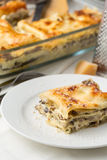 A portion of lasagne with cheese on Royalty Free Stock Photo