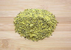 Portion of lemon pepper on a wood cutting board Stock Photography