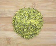 Portion of lemon pepper on a wood cutting board Stock Images