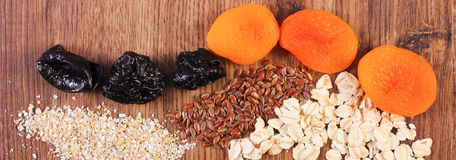 Portion of linseed, rye flakes, oat bran and dried fruits, concept of healthy nutrition and increase metabolism. Ingredients with dietary fiber Stock Image