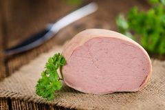 Portion of Liverwurst German cuisine on wooden background sel Royalty Free Stock Photography