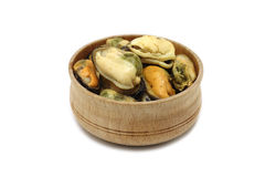 A portion of marinated sea mussels in a wooden bowl. On a white background Royalty Free Stock Photos