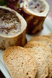 Marrow bone and bread Stock Image