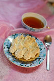 Portion meringue cake. With tea on a table Royalty Free Stock Image