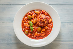Portion of minestrone soup with meatball Stock Photography
