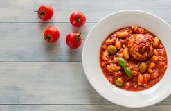 Portion of minestrone soup with meatball Royalty Free Stock Photos