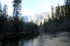 Portion of Mirror Lake, Yosemite National Park, California. Slowly passing into mountain stream. Favorite tourist spot, clear water providing mirror image of Royalty Free Stock Photography