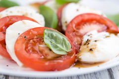 Portion of Mozarella with Tomatoes and Balsamico dressing. (selective focus; close-up shot royalty free stock photo