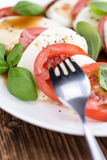 Portion of Mozarella with Tomatoes and Balsamico dressing. Selective focus; close-up shot royalty free stock photography