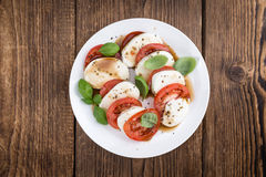 Portion of Mozarella with Tomatoes and Balsamico dressing Stock Photo