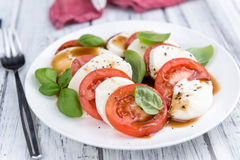 Portion of Mozarella with Tomatoes and Balsamico dressing. (selective focus; close-up shot stock photos