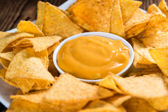 Portion of Nachos (with Cheese Dip) Royalty Free Stock Photo