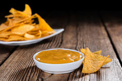 Portion of Nachos (with Cheese Dip) Royalty Free Stock Images