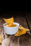 Portion of Nachos (with Cheese Dip) Royalty Free Stock Image