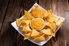 Portion of Nachos (with Cheese Dip) Stock Photos